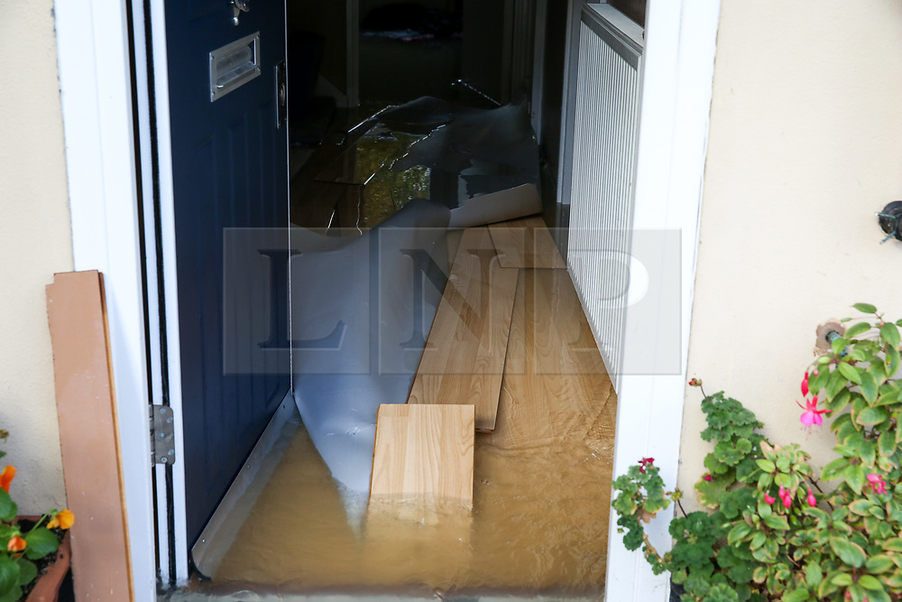 © Licensed to London News Pictures. 08/10/2019. London, UK. Floor boards are uprooted in a ground floor flat following a burst water main on Brownswood Road in Finsbury Park, north London, causing flooding in residential housing estate. Emergency services and Thames Water are at the scene.  Photo credit: Dinendra Haria/LNP