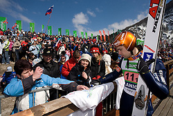 Matti Hautamaeki (FIN) with fans at Flying Hill Team in 3rd day of 32nd World Cup Competition of FIS World Cup Ski Jumping Final in Planica, Slovenia, on March 21, 2009. (Photo by Vid Ponikvar / Sportida)