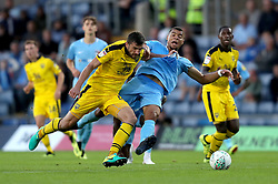 Oxford United's John Mousinho (left) and Coventry City's Maxime Biamou (right) battle for the ball