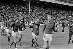 Jubilant England players parade the World Cup around Wembley after their 4-2 win: (l-r) Gordon Banks, Alan Ball, Martin Peters, Bobby Moore, George Cohen, Ray Wilson, Bobby Charlton, Jack Charlton