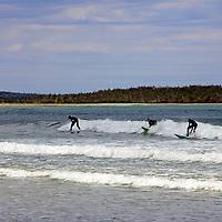 North America, Canada, Nova Scotia. Surfers at Martinique Beach on the Eastern Shore.