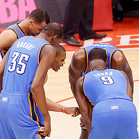 11 May 2014: Oklahoma City Thunder guard Russell Westbrook (0) talks to Oklahoma City Thunder forward Serge Ibaka (9), Oklahoma City Thunder guard Thabo Sefolosha (25), Oklahoma City Thunder forward Kevin Durant (35) and Oklahoma City Thunder center Kendrick Perkins (5) during the Los Angeles Clippers 101-99 victory over the Oklahoma City Thunder, during Game Four of the Western Conference Semifinals of the NBA Playoffs, at the Staples Center, Los Angeles, California, USA.
