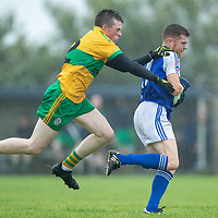 St. Senan's Kilkee's Barry Harte is tackled by O'Curry's Jim Marrinan