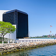 Waterfront of the the John F. Kennedy Presidential Library and Museum on the waterfront in Dorchester in Boston, Massachusetts. Dedicated to the 35th president of the United States, the JFK Library is the official National Archves and Records Administration repository of the presidential records of John F. Kennedy. The highrises of downtown Boston are in the background at right of frame.