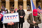 "21 NOVEMBER 2020 - DES MOINES, IOWA: People pray for US President Donald Trump during a ""Stop the Steal"" rally at the Iowa State Capitol. About 100 supporters of President  Trump gathered at the Iowa State Capitol to rally in support of the President and in opposition to the outcome of the US election. They are a part of the ""Stop the Steal"" movement which has spread across the US. This is the third week that there have been ""Stop the Steal"" rallies across the US. Most independent observers and election officials, both Republican and Democratic, have said the election was free and fair and that there was no election fraud.    PHOTO BY JACK KURTZ"