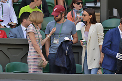 © Licensed to London News Pictures. 06/07/2016.  ANNA WINTOUR, BRADLEY COOPER and girlfriend IRINA SHAYK watch tennis on the centre court on the tenth day of the WIMBLEDON Lawn Tennis Championships. London, UK. Photo credit: Ray Tang/LNP