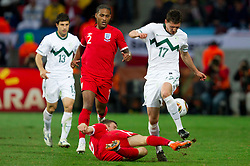 Glen Johnson of England (2) and James Milner of England vs Andraz Kirm of Slovenia during the 2010 FIFA World Cup South Africa Group C Third Round match between Slovenia and England on June 23, 2010 at Nelson Mandela Bay Stadium, Port Elizabeth, South Africa. England defeated Slovenia 1-0 and qualified for the next round, Slovenia not. (Photo by Vid Ponikvar / Sportida)