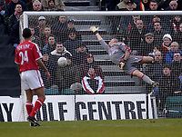 Photo. Glyn Thomas.<br /> Gillingham v Charlton. FA Cup Third Round.<br /> Priestfield Stadium. 03/01/2004.<br /> Mamady Sadibe's header to score Gillingham;s second goal goes past the outstretched arms of Dean Kiely (R) as Jon Fortune looks on in horror.