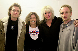 Popi Cassevetis DEF Leppard fan who travelled half way round the world to see the band play live in their home city last night. (Feb 20th 2003) She is on a 6,700-miles round trip - from Newark, New York and will fly home on Sunday<br />with left to right Drummer Rick Allen, Bass Guitarist Rick Savage and Guitarist Phil Collen.<br /><br />Def Leppard Live at the Hallam FM Arena, In thier Home town of Sheffield in South Yorkshire, England<br /><br />Copyright Paul David Drabble