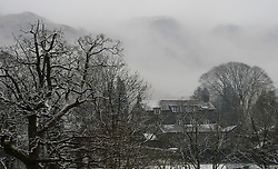 © Licensed to London News Pictures. 08/03/2016. Cumbria, UK. A light covering of snow in Elterwater, Cumbria as more cold and wet weather hits the UK. Photo credit : Anna Gowthorpe/LNP