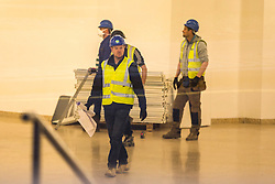 © Licensed to London News Pictures. 31/03/2020. Harrogate UK. Workmen inside the the Harrogate Convention Centre in Harrogate this morning that is being turned into a NHS Nightingale hospital in the fight against coronavirus. The Convention Centre is the latest facility to be announced as a chosen site, joining the National Exhibition Centre (NEC) in Birmingham, the Manchester Central Complex, and the ExCeL conference centre in East London, to help deal with the rising number of coronavirus cases.Photo credit: Andrew McCaren/LNP