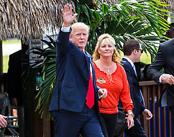October 24, 2016 - Florida, U.S. - Donald Trump leaves a farmer's roundtable event at Bedner Farms with the co-owner, Marie Bedner,  Monday, October 24, 2016. (Credit Image: © Lannis Waters/The Palm Beach Post via ZUMA Wire)