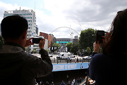 Fans take pictures of the stadium ahead of the Premier League match at Wembley Stadium, London.
