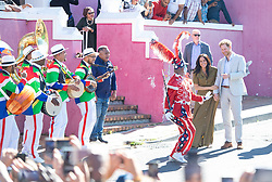 The Duke and Duchess of Sussex watch a dancer in costume during a visit a Heritage Day event in Bo-Kaap, Cape Town, on day two of the Royal couple's visit to South Africa. PA Photo. Picture date: Tuesday September 24, 2019. See PA story ROYAL Tour . Photo credit should read: Dominic Lipinski/PA Wire
