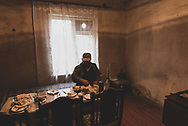 An Armenian man waits for other to join him for lunch at a home in a village near Agdam, in the disputed territory of Nagorno-Karabakh.<br /> <br /> (September 24, 2016)