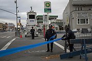 Police officers set up tape before the New York City Marathon on 4th Ave in Brooklyn, NY on Sunday, Nov. 3, 2013.<br /> <br /> CREDIT: Andrew Hinderaker for The Wall Street Journal<br /> SLUG: NYSTANDALONE