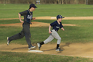 Goshen, New York - A John S. Burke Catholic player, at left, and a a coach's son run around the bases after a varsity boys' baseball game on April 21, 2014.