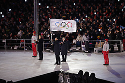 February 25, 2018 - Pyeongchang, KOREA - Beijing Mayor, (who is host city for 2022 winter Olympics) waves the Olympic flag as IOC president Thomas Bach and Pyeongchang mayor look on, during the closing ceremony for the Pyeongchang 2018 Olympic Winter Games at Pyeongchang Olympic Stadium. (Credit Image: © David McIntyre via ZUMA Wire)