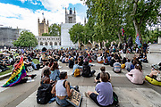 People holding placards organised by Black Lives Matter and most of them wearing surgical face masks are holding the seventh weekend of protests in Parliament Square, Central London on Saturday, July 11, 2020. <br /> Anger against systemic levels of institutional racism have raged through the city, and worldwide; sparked by the death of George Floyd who died on May 25 after he was restrained by Minneapolis police in the United States. (VXP Photo/ Vudi Xhymshiti)