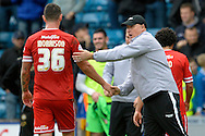 Cardiff City Manager Russell Slade with Sean Morrison of Cardiff City after the final whistle.  Skybet football league championship match , Millwall v Cardiff city at the Den in Millwall, London on Saturday 25th October 2014.<br /> pic by John Patrick Fletcher, Andrew Orchard sports photography.