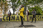 Activists play drums in Canonbury Road, nearby Highbury and Islington Station, on Thursday, Oct 1, 2020 to mark the 'National Tree Killing Day' outside the Dixon Clark Court development plan. (VXP Photo/ Sabrina Merolla)
