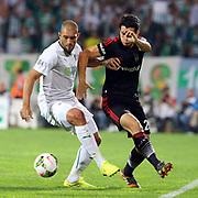 Besiktas's Necip Uysal (R) during the Turkish soccer super league match Bursaspor between Besiktas at the Ataturk Stadium in Bursa Turkey on Monday, 22 September 2014. Photo by TURKPIX