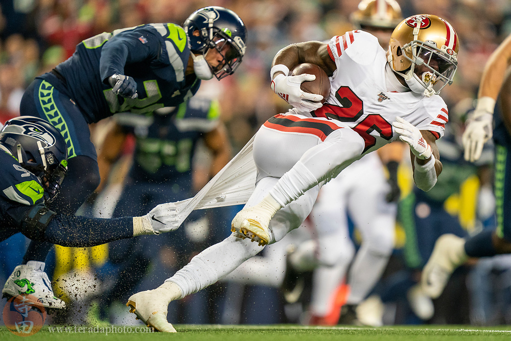 December 29, 2019; Seattle, Washington, USA; San Francisco 49ers running back Tevin Coleman (26) during the first quarter against the Seattle Seahawks at CenturyLink Field.
