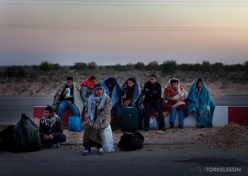 Refugees from Libya cross the border to Tunisia at the Ras Jedir border crossing i feb 2011. The exodus from Libya continued through the year.
