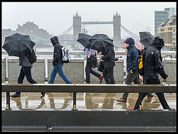 June 6, 2017 - London, London, United Kingdom - Image ©Licensed to i-Images Picture Agency. 06/06/2017. London, United Kingdom. London Bridge Terror Attack - Day 4...Londoners brave the rain to cross London Bridge. Steel barriers have been erected across the bridge to prevent a repeat of the Westminster and London Bridge terror attacks were terrorist used vehicles to mow down pedestrians. Seven people lost their lives and 48 were injured in Saturday's attack on London Bridge and Borough Market...Picture by Pete Maclaine / i-Images (Credit Image: © Pete Maclaine/i-Images via ZUMA Press)