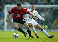 Photo. Aidan Ellis.<br />Leeds United v Manchester United.<br />FA Barclaycard Premiership.<br />18/10/2003.<br />Leeds Seth Johnson  and Manchester's Roy Keane