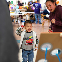 Keilan McNeill, 5, and his mother Crystal McNeill play the bean bag toss Saturday afternoon at the Rio West mall for the Relay For Life kickoff event.