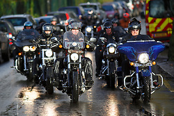 © licensed to London News Pictures. London, UK 03/01/2014. Hells Angels outriders leading the procession to the funeral of Great Train Robber Ronnie Biggs at Golders Green crematorium in north London. Biggs died on December 18, 2013 aged 84 after famously spent 35 years on the run from prison. Photo credit: Tolga Akmen/LNP