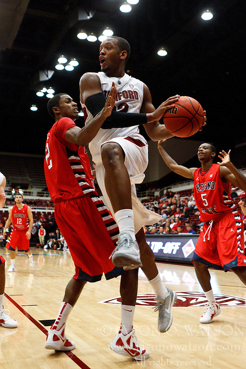 Nov 14, 2011; Stanford CA, USA;  Stanford Cardinal guard Jarrett Mann (22) is fouled by Fresno State Bulldogs guard Jonathan Wills (left) during the second half of a preseason NIT game at Maples Pavilion. Stanford defeated Fresno State 75-59. Mandatory Credit: Jason O. Watson-US PRESSWIRE