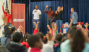 Chameka Scott, Ellis Wyms, Abiloa Wabara, Kami Craig and Lewis Senior talk with students during a Touchdown Houston Read On literacy program at Ross Elementary School, December 2, 2016.