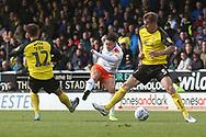 Luton Town forward Harry Cornick (14) shoots at goal during the EFL Sky Bet League 1 match between Burton Albion and Luton Town at the Pirelli Stadium, Burton upon Trent, England on 27 April 2019.