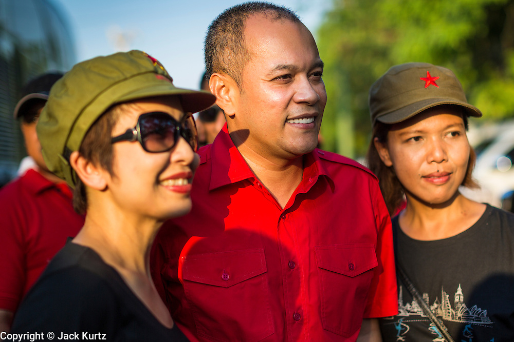 10 MAY 2014 - BANGKOK, THAILAND: NATTAWUT SAIKUA, a leader of the Red Shirt movement, greets supporters when he arrived at a Red Shirt rally in Bangkok. Thousands of Thai Red Shirts, members of the United Front for Democracy Against Dictatorship (UDD), members of the ruling Pheu Thai party and supporters of the government of ousted Prime Minister Yingluck Shinawatra are rallying on Aksa Road in the Bangkok suburbs. The government was ousted by a court ruling earlier in the week that deposed Yingluck because the judges said she acted unconstitutionally in a personnel matter early in her administration. Thailand now has no functioning government. Red Shirt leaders said at the rally Saturday that any attempt to impose an unelected government on Thailand could spark a civil war. This is the third consecutive popularly elected UDD supported government ousted by the courts in less than 10 years.    PHOTO BY JACK KURTZ