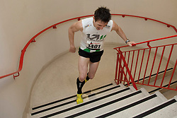 © Licensed to London News Pictures. 01/03/2012. LONDON, UK.   Stair runner Thomas Dold breaks the record for the fastest time to reach the top of Tower 42, running the course in 3m 58s, beating the previous event record of 4m 22s. Today (01/03/12) a host of elite athletes celebrities joined 1,200 people to run up the 920 steps of Tower 42, raising £250,000 for housing charity Shelter. Now in its fourth year, the award-winning Vertical Rush will once again take place at London's original skyscraper, Tower 42.. Photo credit: Matt Cetti-Roberts/LNP