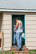 Clayvin Herrera picking up his daughter, Twoots, at her mother's home in Dunmore, Montana, on the Crow Reservation.