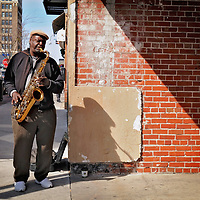 Musician Glen McRae, 51, plays the saxophone for tips on Front Street in downtown Wilmington, N.C. on Friday, March 15, 2013. McRae, a native of Burgaw, N.C. who grew up in Richmond, VA, recently returned to the area and enrolled at Cape Fear Community College and is studying music education. McRae can usually be found performing at open mic night at the Rusty Nail on Tuesday's, located at 1310 S. 5th Street. Photo by Mike Spencer