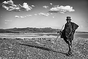 An older man from the Turkana tribe standing on a hilltop above Lake Turkana, black and white,Lake Turkana, Loiyangalani,Kenya, Africa
