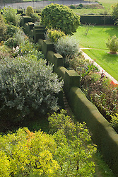 View from the roof at Great Dixter showing yew hedge separating Long Border from the High garden
