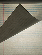 close up of a folded over white legal pad