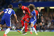 David Luiz of Chelsea holds onto Divock Origi of Liverpool. Premier league match, Chelsea v Liverpool at Stamford Bridge in London on Friday 16th September 2016.<br /> pic by John Patrick Fletcher, Andrew Orchard sports photography.