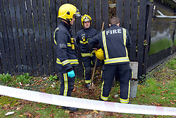 © Licensed to London News Pictures. 16/11/2012. Streatham, UK Fire officers at the scene. The fire took place behind an advertising hoarding. Two people have died and another is in hospital with burns after a fire on wasteland in south London. Firefighters were called to the scene in Streatham High Road, Streatham, just after 02:20 GMT. Two bodies were found at the scene and a third person was taken to hospital for treatment. Crews took just over an hour to bring the fire under control. The incident is being investigated by the London Fire Brigade and the Metropolitan Police. Photo credit : Stephen Simpson/LNP