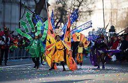 © London News Pictures. 01/01/2013. London, UK.  Dancers from the National Carnival Guild take part in the 2012 New Years Parade through the centre London on January 1st, 2013. Photo credit : Ben Cawthra/LNP