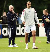 Photo: Chris Ratcliffe.<br />England training session. 06/06/2006.<br />Sven Goran Eriksson watches Rio Ferdinand in England's first training session.