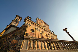 THEMENBILD - Die Lombardei ist eine norditalienische Region mit einer Fläche von 23.863 km und ca.9,8 Mio. Einwohnern. Sie ist in zwölf Provinzen aufgeteilt und liegt zwischen Lago Maggiore, Po und Gardasee. Bilder aufgenommen am 21. August 2013, im Bild Westfassade Pfarrkirche Chiesa Sancto Ambrosio im Abendlicht, Luganersee, Lago di Lugano, Porto Ceresio // THEMES PICTURE - Lombardy is a northern Italian region with an area of 23,863 km and a population of 9,8 Mio. It is divided twelve provinces and is situated between Lake Maggiore, Lake Garda and Po. Pictured on 2013/08/21. EXPA Pictures © 2013, PhotoCredit: EXPA/ Eibner/ Michael Weber<br /> <br /> ***** ATTENTION - OUT OF GER *****