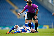 Referee Anthony Backhouse stands over the injured Lewis Holtby of Blackburn Rovers  during the EFL Cup match between Blackburn Rovers and Doncaster Rovers at Ewood Park, Blackburn, England on 29 August 2020.