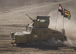 November 26, 2016 - Mosul, Nineveh Governorate, Iraq - Iraqi army armoured humvee at the suburbs of Mosul, returning from the battle. (Credit Image: © Berci Feher via ZUMA Wire)