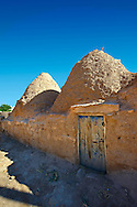 """Pictures of the beehive adobe buildings of Harran, south west Anatolia, Turkey.  Harran was a major ancient city in Upper Mesopotamia whose site is near the modern village of Altınbaşak, Turkey, 24 miles (44 kilometers) southeast of Şanlıurfa. The location is in a district of Şanlıurfa Province that is also named """"Harran"""". Harran is famous for its traditional 'beehive' adobe houses, constructed entirely without wood. The design of these makes them cool inside. 45 .<br /> <br /> If you prefer to buy from our ALAMY PHOTO LIBRARY  Collection visit : https://www.alamy.com/portfolio/paul-williams-funkystock/harran.html<br /> <br /> Visit our TURKEY PHOTO COLLECTIONS for more photos to download or buy as wall art prints https://funkystock.photoshelter.com/gallery-collection/3f-Pictures-of-Turkey-Turkey-Photos-Images-Fotos/C0000U.hJWkZxAbg ."""